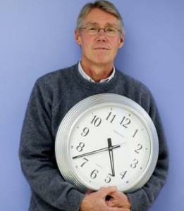 image of Tim holding a clock